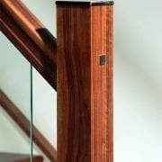Metal newel post cap used in Glass staircase design