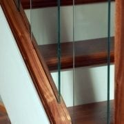 Rake glass panels used in Modern, Glass staircase design | George Quinn Stair Parts Plus