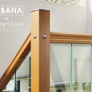 Glass-Stairs-Landing-Closeup-with-Oak-George-Quinn-Stair-Parts-Urbana